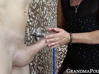 Fascinating grannie in stocking unwraps twink to deep throat hard on