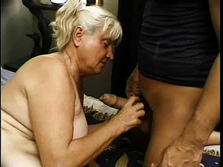 Nasty mature female entices a youthful boy and has him deeply banging her fur covered vagina