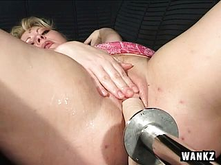 Crazy light haired stunner fumbles her puss while taking it from a machine
