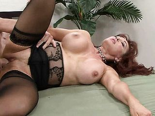 Mature red haired with a immense pair of bumpers gets a shafting