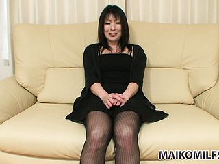 Enticing Chinese mummy in a handsome dark hued sundress shares her sexual dreams and cravings