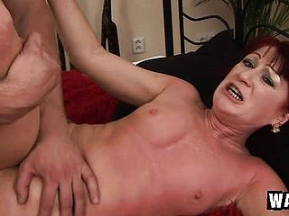 Mature red haired Esmeralda gets pleased by smashing a huge beef whistle
