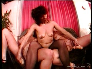 Lesbian threesome among horny ladies in vintage video