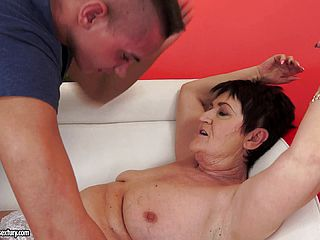 Mature brunette is fucked by a studs hard cock