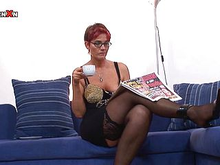 Mature redhead is fucked by her man on camera