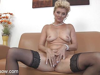 Blonde granny plays with her wet pussy