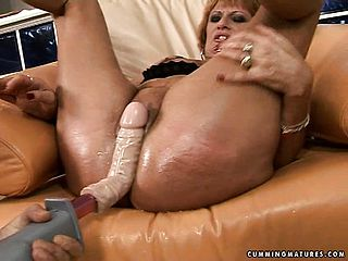 Luscious ginger haired mature Mabel has a large romp plaything penetrating her fuckbox