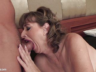 Mature bitch gives head and gets nailed
