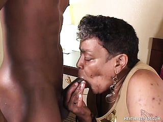 Mischievous black lady has a youthfull dark hued stud porking her sore slit from behind