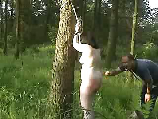 Round fuckslut gets corded up in the forrest