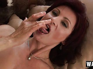 Ultra kinky mature sandy haired Wanda drives a blue fake penis in and out of her juicy peach