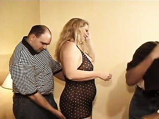 Insatiable mature duo getting involved in an strong three way at home