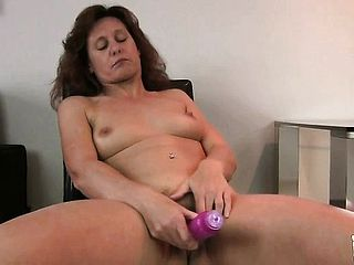 Nasty mature doll Inge uses a purple massager to please her needs