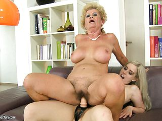 The blondie mummy gets her furry vulva poked by the strap on dildo fuck stick and likes it