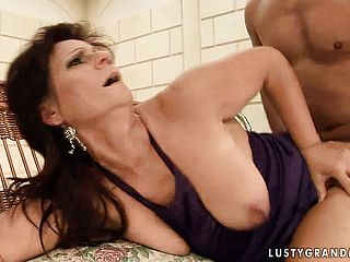 Buxomy dark haired mother deep throats a thick man rod and then nails it with eagerness