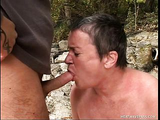 Big grannie gets her needy fuck holes romped by the side of a lake