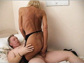 Hardcore platinum blonde GILF in beautiful ebony undergarments takes her boy nut deep