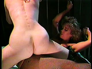 A kinky prisoner taunts the marvelous doll guard into some labia have fun