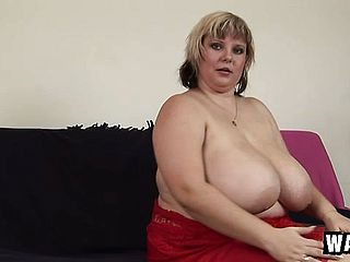 Obese blond doll with huge bumpers plays with a big romp plaything