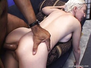 Short-haired blond grandma gets her slots fucked in a threeway
