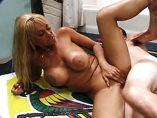 Blonde Cougar with faux udders gets tongued and dicked, then hooter nails