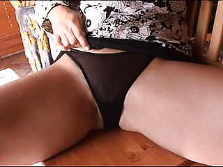 Terrific harlot puts her forearm under ebony undies and taunts her wettened clittie before drilling