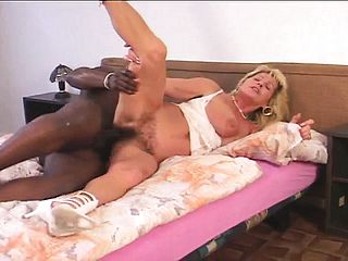 Curvy blond cougar has a thick ebony spunk pump tearing up her fur covered vagina