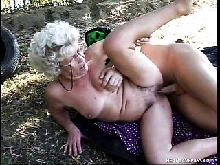Lusty grannie knows how to service a bone and enjoys doing it outdoors