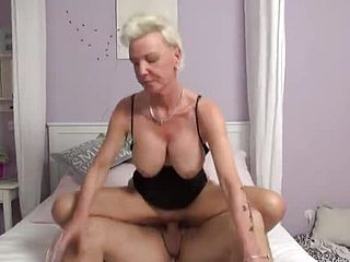 Alluring big titted mature gal brings stud to orgasm
