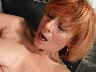 Lollipop hungering ginger haired mature uses a faux cock to sate her sore peach