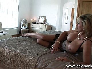 Sensational blond wifey flashes her figure and drives herself to ejaculation
