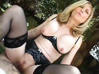 Lewd platinum blonde cougar in dark hued undergarments deep throats and drills a large man meat in the outdoors