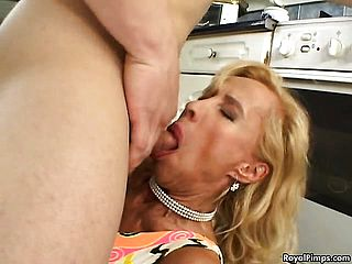 Desirable towheaded cougar has a youthful stud pounding her cooter in the kitchen