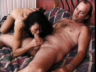 Wild Asian damsel lies on the couch to have a youthfull boy screwing her unshaved cooch deep