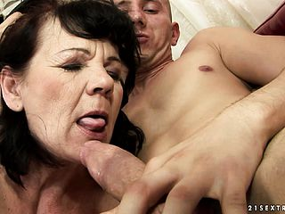 Enormous grandmother tongues up his joint and gets it pushed in her wooly pussy