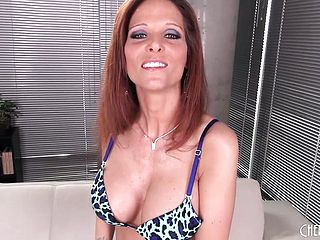 Redheaded Mummy in mesh stocking thumbs herself in a solo demonstrate
