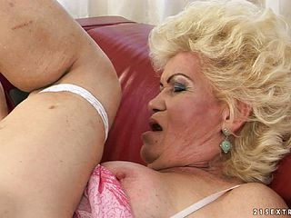 Light haired mature nymph with thick boobs gets her gash ate and pummeled on the couch