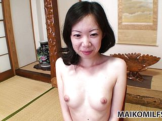 This naughty Asian dame with super cute baps and a unshaved cooch is anxious to sate her urges